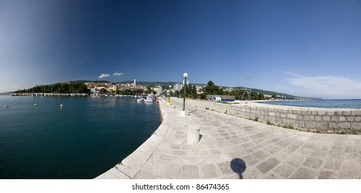 Pier in the Crikvenica port with the panoramic view of the landscape