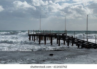 Pier during sea storm shot on cloudy day