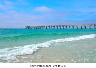 Pier extending out over the blue green ocean at Panama City, FL, USA