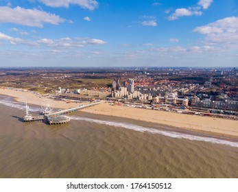 Pier with Ferris Wheel at Northern Sea Scheveningen Beach , located near the Hague city aerial drone footage. Popular Dutch beach resort Scheveningen With a clouds on the Sky in a day
