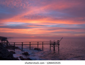 Pier for fishermen and Amazing paradise colours of the sunrise  in the atlantic ocean near Nantes in France.