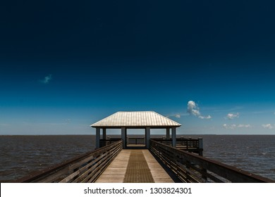 Pier to the Gulf of Mexico with dark ble sky, Scene from Panahndle Florida