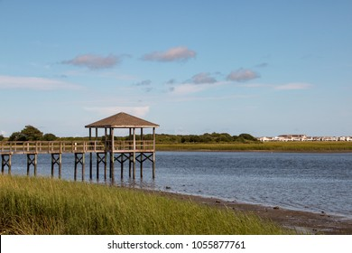 Pier with hut ocean isle north carolina nc with wooden planks and marsh in foreground and mud