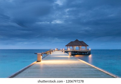 Pier into the ocean Raa Atoll Island Maldives.