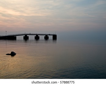 Pier jutting out into a calm Lake
