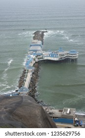 Pier jutting out into the ocean in Lima Peru