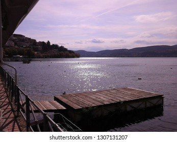 Pier at the lake of Kastoria , Greece just before sunset