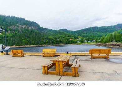 Pier and landscape of the Saguenay Fjord in Sainte-Rose-du-Nord, Quebec, Canada
