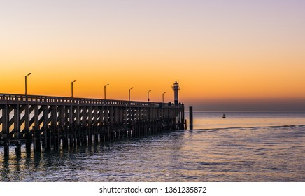 the pier with light house in Blankenberge, Belgium, Sunset at sea