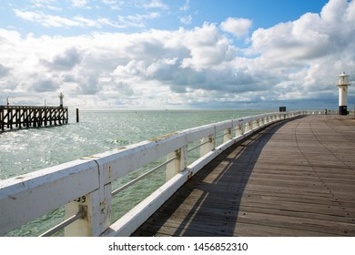 Pier with lighthouse near Blankenberge in Flanders, Belgium