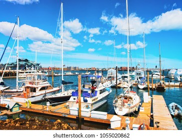 Pier of the Long Wharf with Custom house Block and sailboats in Charles River in Boston, Massachusetts, the United States.