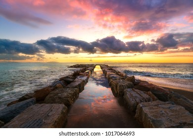 Pier in Maremma coast. Sunset time. Mediterranean sea Marina di Cecina, Tuscany, Italy Europe.