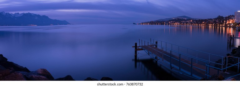 Pier in Montreux just after sunset with a blue light in the winter