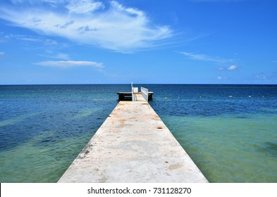 Pier on beautiful Jamaica beach. Montego Bay, Jamaica, September 2017.
