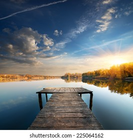 Pier on a calm river in the autumn