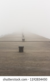 A pier on Lake Michigan obscured by thick fog.  Sheboygan, Wisconsin, USA.