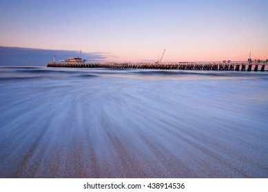 The pier of Oostende at sunset, Belgium.