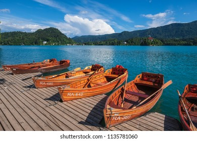 Pier with rent boats on a famous Bled lake in Slovenia. Famous summer weekend travel destination