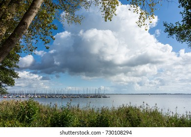 Pier with sailboats on the shore of Lake Steinhude in Mardorf