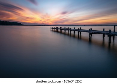 Pier at steinhude lake before sunrise as longexposured picture