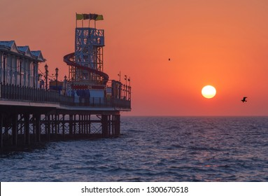 A pier at Sunrise in the UK. Paignton Pier, Located in Torbay, Devon, UK.