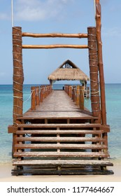 Pier and thatched hut on the island of Cozumel, Mexico