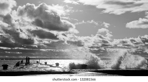 Pier in turbulent and stormy sea