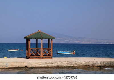 Pier and two boat at seaside in Greece