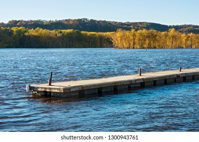 pier waters and wooded islands of mississippi river backwaters during autumn in prairie du chien wisconsin