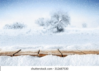 pier of wood and snow