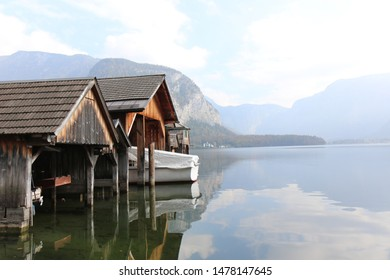 Pier of wooden planks, Boatshed on the River in house.