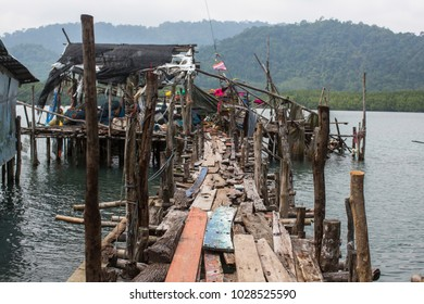 Pier of wooden planks in the Thai fishing village.