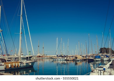 pier with yachts at sea on a bright Sunny day