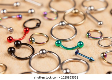 piercing earrings, on a wooden background