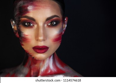 piercing eyes with brown eyes, Euro-Asian girl whose beauty envied all the girls, spoils in the art of make-up only emphasizes her unusualness and her black background intensifies.