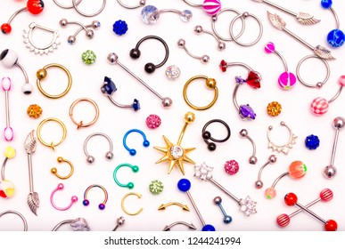 Piercing jewelry isolated on a white background set of earrings for the body, nose, navel, tongue, nipples, ear a diverse ornament of beauty cosmetological body piercing jewelry set