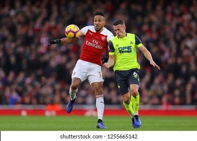 Pierre-Emerick Aubameyang of Arsenal battlers with Jonathan Hogg of Huddersfield Town - Arsenal v Huddersfield Town, Premier League, Emirates Stadium, London (Holloway) - 8th December 2018