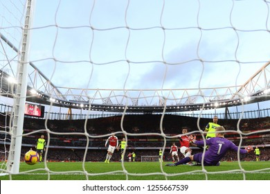 Pierre-Emerick Aubameyang of Arsenal beats Jonas Lossl of Huddersfield Town but his effort misses - Arsenal v Huddersfield Town, Premier League, Emirates Stadium, London (Holloway) - 8th December 2018