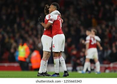Pierre-Emerick Aubameyang and Hector Bellerin of Arsenal celebrate the win over Huddersfield Town - Arsenal v Huddersfield Town, Premier League, Emirates Stadium, London (Holloway) - 8th December 2018