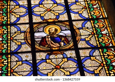 Pierremont, Hauts-de-France/France-November 28 2018: internal illumination reveals the details of the stained glass windows of a rural French church
