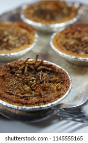 Pies with Beetle Larvae baked in, as well as pecans, corn syrup, and pie crust