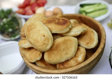 Pies on a wooden plate at buffet