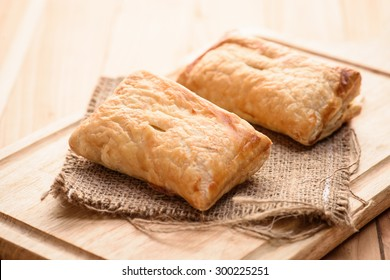 Pies of puff pastry close up on an sack background