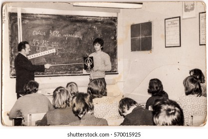 PIESZYCE, POLAND, CIRCA 1970's: Vintage photo of a teacher and pupils during a math lesson