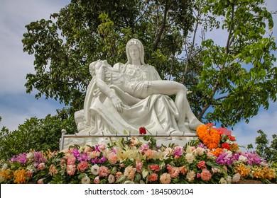 The Pieta Mother Mary holding body of Jesus catholic statue