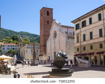 Pietrasanta  Italy _ August 14, 2017: small town in Versilia norther Tuscany main square with the Duomo Cathedral of St. Martin and sculptures