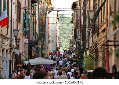 Pietrasanta, Lucca, Italy - 26 August 2020: people and masks in the historic center of Pietrasanta.