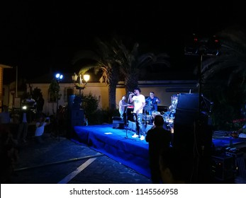 "Pietrelcina, Benevento, Campania, Italy - July 29, 2018: Migrant of the reception center who sings with Gege Telesforo at the 14th edition of the ""Jazz under the stars"" music festival"