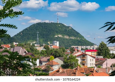 Pietricica hill with cable car passing and the skyline of Piatra Neamt