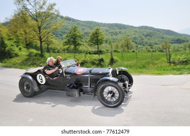 PIEVE S. STEFANO (AREZZO), ITALY - MAY 13: A 1926 built yellow Fiat 509 Sport driven by J. Maes and P.Van Schoubroeck car at a time trial at 1000 Miglia race on May 13, 2011 near Pieve S. Stefano (AR)